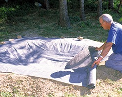 laying geotextile - Building Fish Ponds